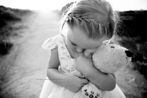 little girl and teddy